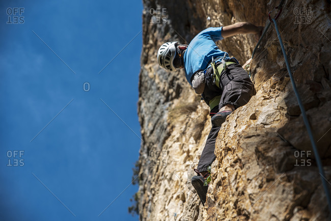 Climber in the right side and the blue sky in the left