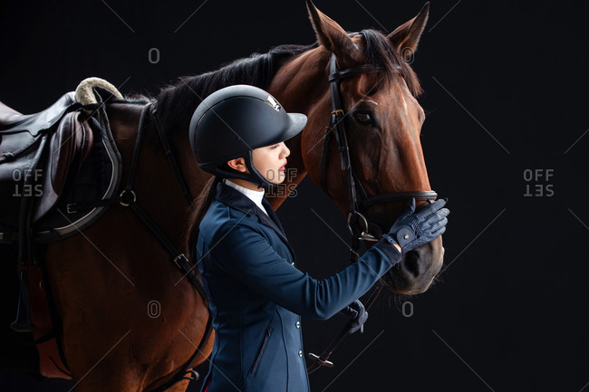 To placate horse young woman
