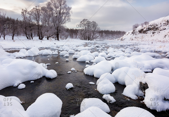 Inner mongolia stretching over frozen river