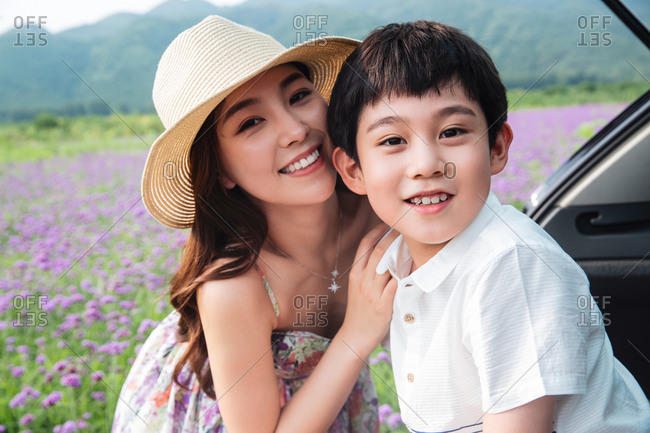 Happy mother and son play outdoors