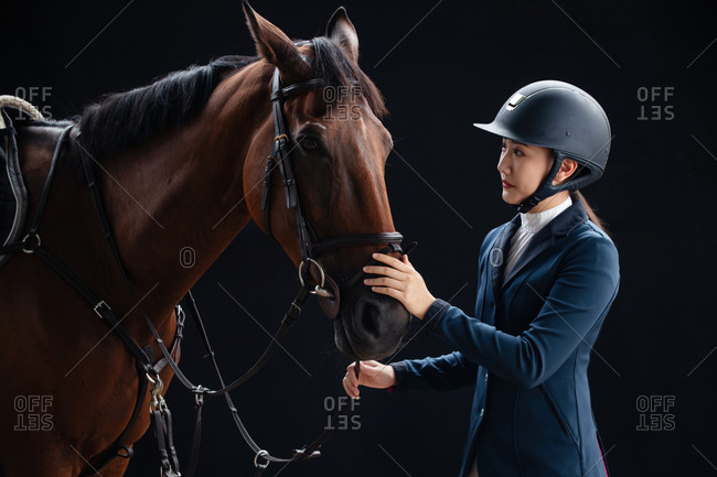 A beautiful young woman and a horse