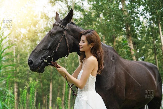 Beautiful women in the skirt the horse