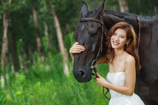 Arm around the horse's beautiful young women