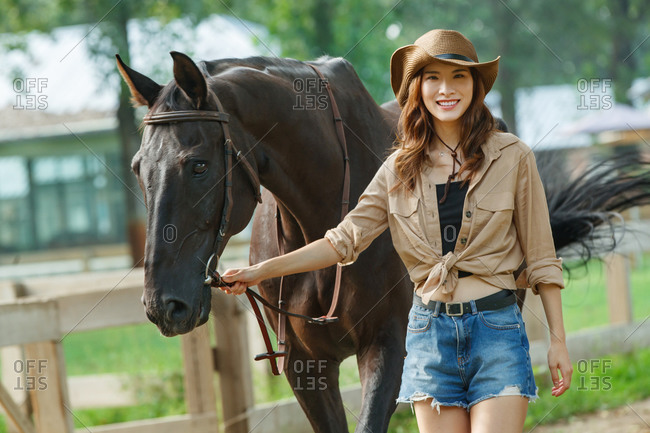The horse young woman of fashion and personality