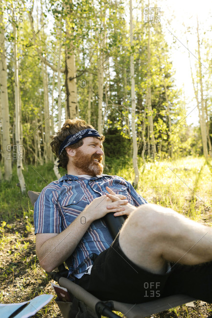 USA, Utah, Uinta National Park, Man relaxing while camping in forest