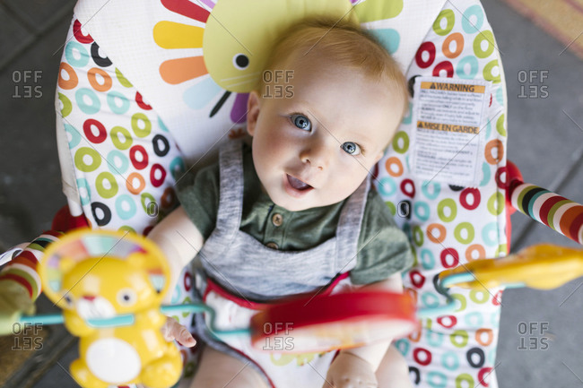 Portrait of baby boy (6-11 months) in baby bouncer