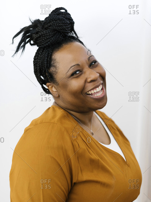 Portrait of smiling woman with black braided hair