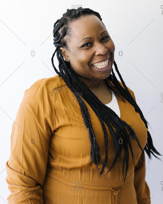 Studio portrait of braided smiling woman