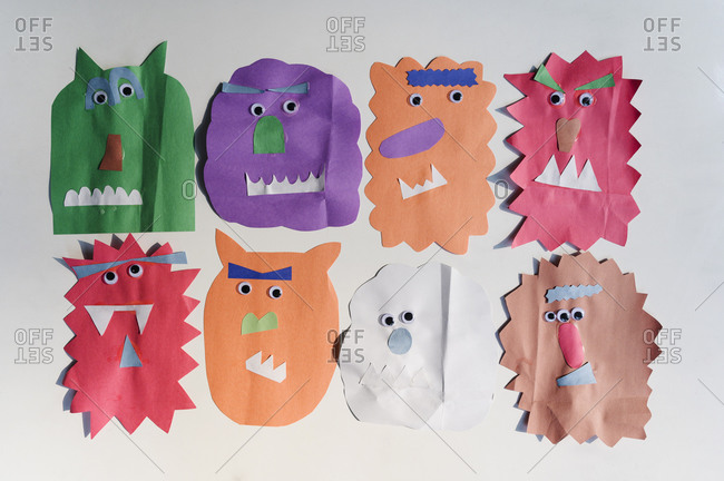 Colorful paper cutouts in a row