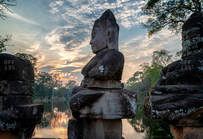 Angkor Archaeological Park, Siem Reap, Cambodia. South gate of Angkor Thom.  Good gods in hindu epic tale of a tug of war between good vs evil in the story the churning of the sea of milk.