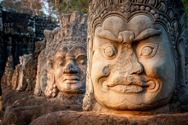 Angkor Archaeological Park, Siem Reap, Cambodia. South gate of Angkor Thom.  Bad gods in hindu epic tale of a tug of war between good vs evil in the story the churning of the sea of milk.