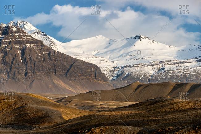 The snow covered mountains and tundra around the Jokulsarlon glacial lagoon, bordering Vatnajokull National Park in southeastern Iceland