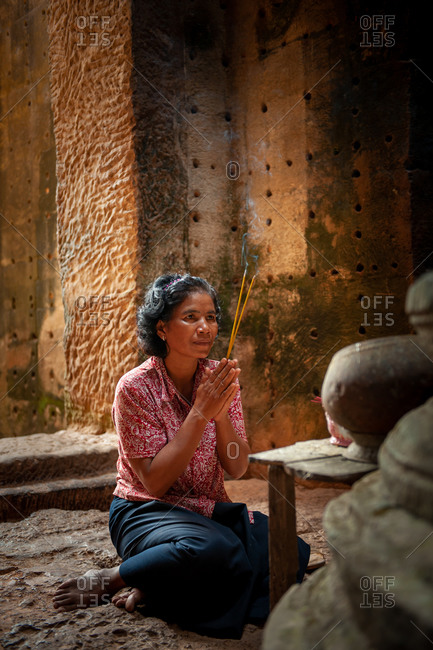 SIEM REAP, CAMBODIA - 25 February 2012: Local lady praying at central tower of Preah Khan Temple, Angkor Park.