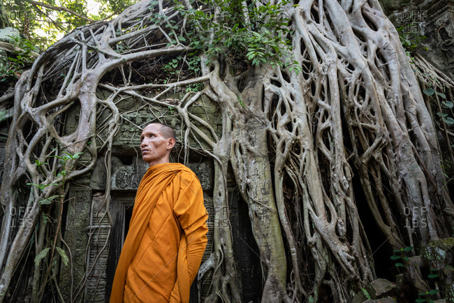 TA PROHM, ANGKORIAN TEMPLE, SIEM REAP, CAMBODIA - 17 August 2014: Monks appreciate temple environment.