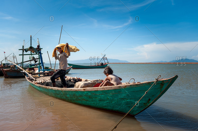 KAMPOT PROVINCE, CAMBODIA - 29 November 2009: Fisherman gets ready for a night out at sea.