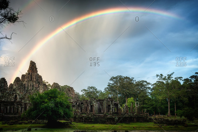 Angkor Archaeological Park, Siem Reap, Cambodia. Rainbow over Bayon Temple in Angkor Thom.