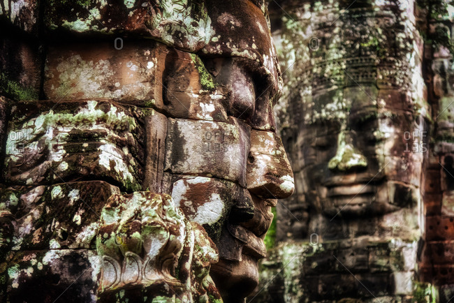 Angkor Archaeological Park, Siem Reap, Cambodia. Close up of two  Buddhas faces of Bayon