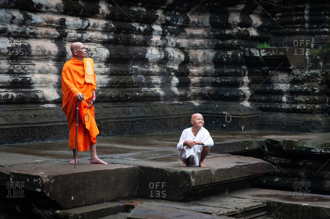 SIEM REAP, CAMBODIA - 15 September 2012: Monk and nun in open court yard of Angkor Wat