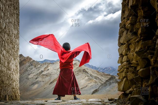 Lamayuru Monastery, Ladakh - 28 July 2019: Monk catching some fresh air.