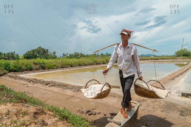 KAMPOT PROVINCE, CAMBODIA - 04 June 2013: Local works in salt fields.