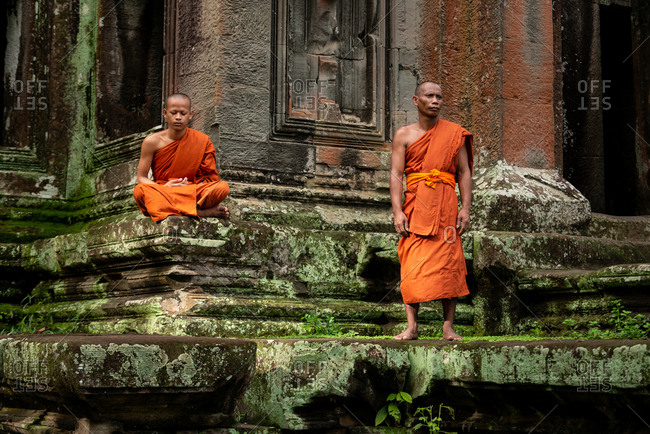 SIEM REAP, CAMBODIA - 10 August 2013: Monks at north gate Angkor Wat