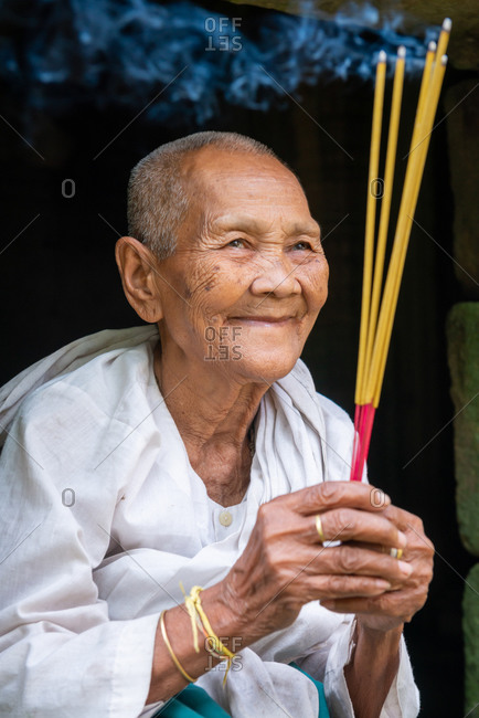 PREAH KHAN, ANGKOR PARK, CAMBODIA - 29 September 2013: Nun praying