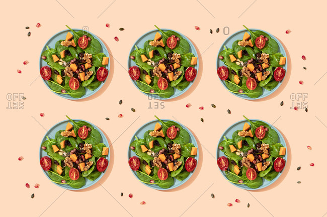 Pattern of plates of fresh ready-to-eat vegan salad