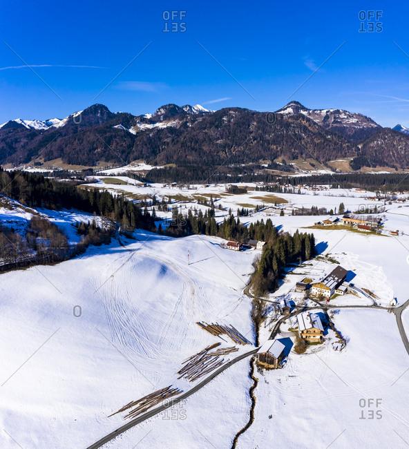 Austria- Tyrol- Kossen- Helicopter view of mountain village in snow-coveredLeukental valley