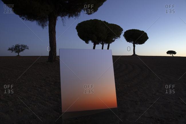 Mirror reflecting sky at dusk inLagunasdeVillafafilanature reserve