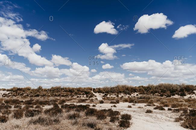 Spain- Navarre- Clouds over desert landscape of Bardenas Reales