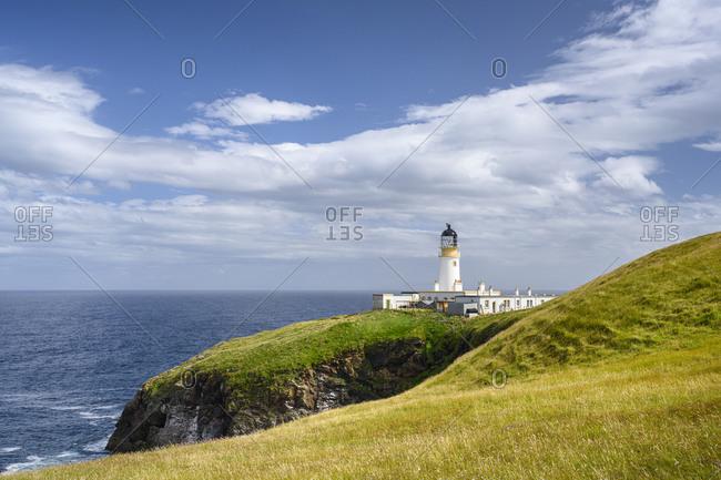 UK- Scotland- Clouds over Tiumpan Head Lighthouse