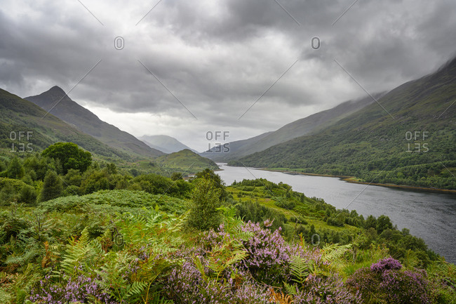 Clouds over lush shore ofLoch Leven