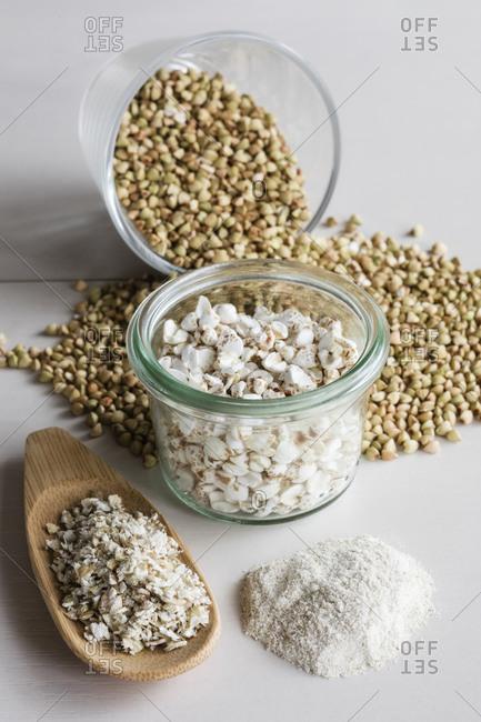 Studio shot of buckwheat grains- pops- flakes and flour