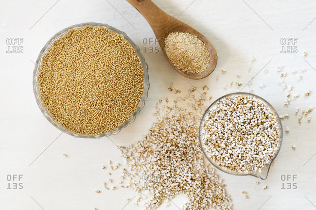 Studio shot of two bowls and ladle ofquinoa grains- pops and flakes