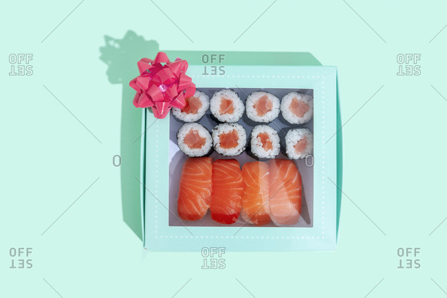 Studio shot of gift box with maki sushi and nigiri