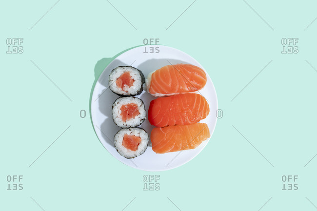 Studio shot of plate of maki sushi and nigiri