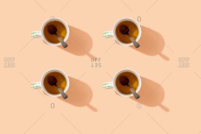 Studio shot of four mugs of herbal tea