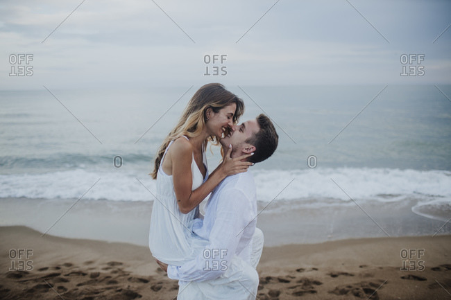 Romantic couple rubbing nose while standing at beach