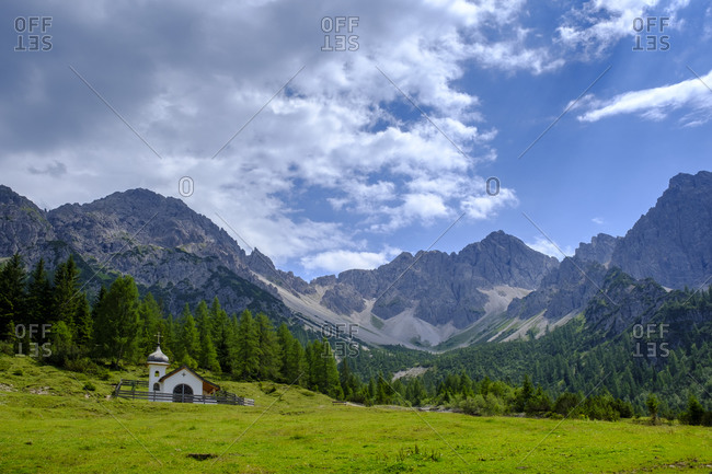 Scenic view of lone chapel in Karwendel mountains during summer
