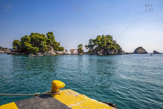 Greece- Preveza- Parga- Marina bollard withPanagiaChapel in background