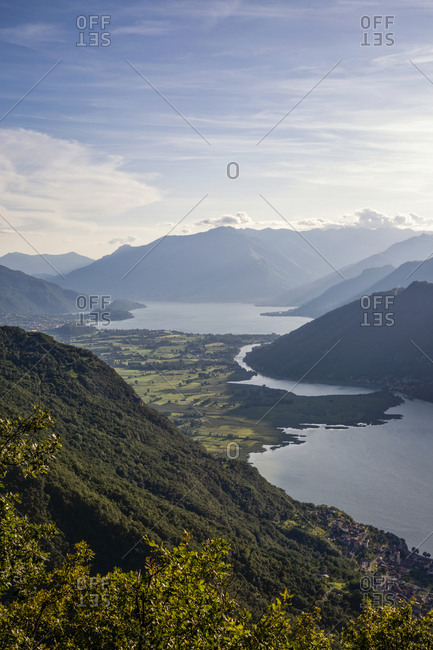 Italy- Province of Sondrio- Scenic view of Lake Mezzola in Riserva Naturale Pian di Spagna e Lago di Mezzola at dusk