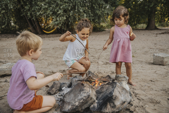 Kids making barbecue at beach