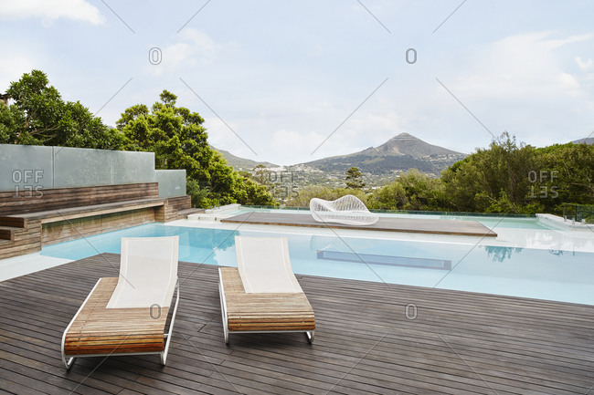 Swimming pool with deck chair