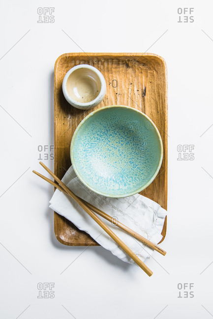 Overhead Top Down Asian inspired kitchenware blue bowl and chopsticks