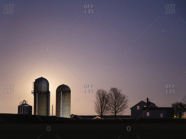 Blue Moonrise silhouettes Vermont Farm house and silos