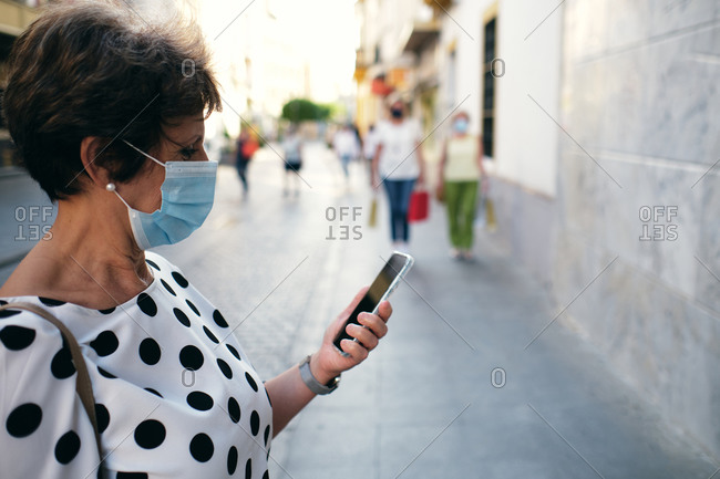 Woman looked at her cell phone during a walk