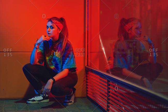 Young woman with urban style posing on the street.
