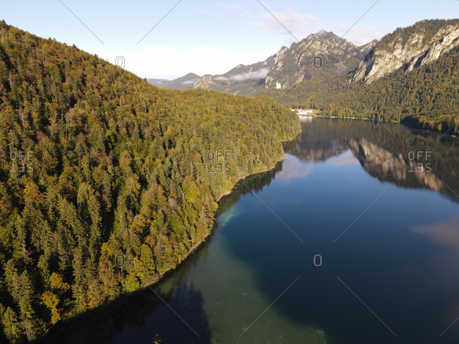 Aerial image of lake Alpsee with Neuschwanstein Castle in the distance