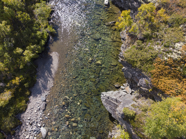 Birdseye view of a turquoise creek during autumn in Norway