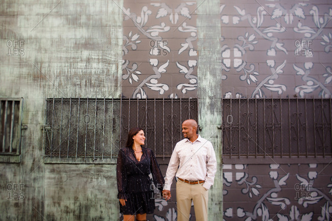Late Forties Couple Standing in Front of Mural in San Diego